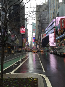 Photo by Christie Wisniewski. Edge of a rainy Times Square.